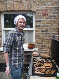 Tom supervises the BBQ